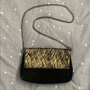 Black suede clutch with removable gunmetal chain
